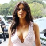Kim Kardashian cuts a triumphant figure in a plunging dress as she shops for camera gear in Calabasas